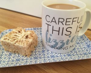 Cup of tea and piece of gluten free crispy rice square