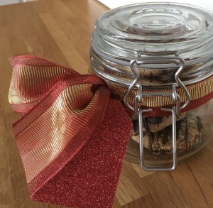 Gluten free biscuits in a glass jar with a ribbon.