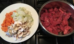 Raw diced beef, onions, mushrooms and carrots