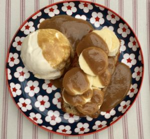 Gluten free banana loaf, with chopped banana, vanilla ice -cream and butterscotch sauce and vanilla ice cream