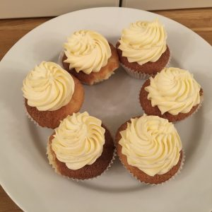 Gluten free buns decorated with buttercream