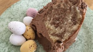 Slice of gluten free chocolate marble Easter cake