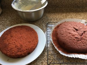 Decorating gluten free red velvet cake with a cream cheese frosting