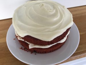 Decorated gluten free red velvet cake with a cream cheese frosting