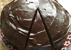 Gluten free chocolate cake topped with ganache