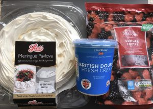 Lees Meringue pavlova, fresh double cream and frozen summer fruits all from Aldi.