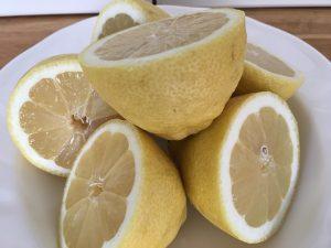 Fresh lemons cut in half to make lemon curd