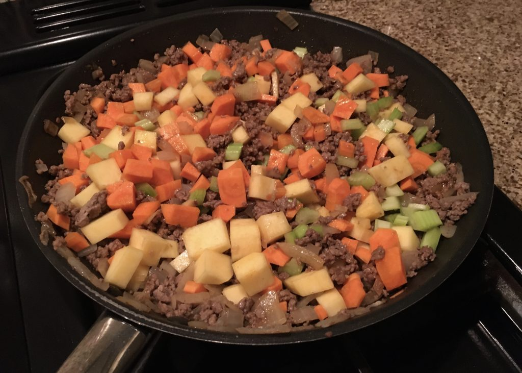 Diced vegetables and minced beef in a frying pan in preparation for my comforting cottage pie.