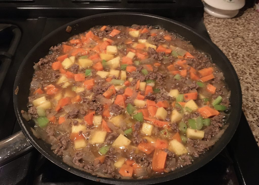 Minced beef with lots of veggies in a deep frying pan ...preparation for cottage pie.