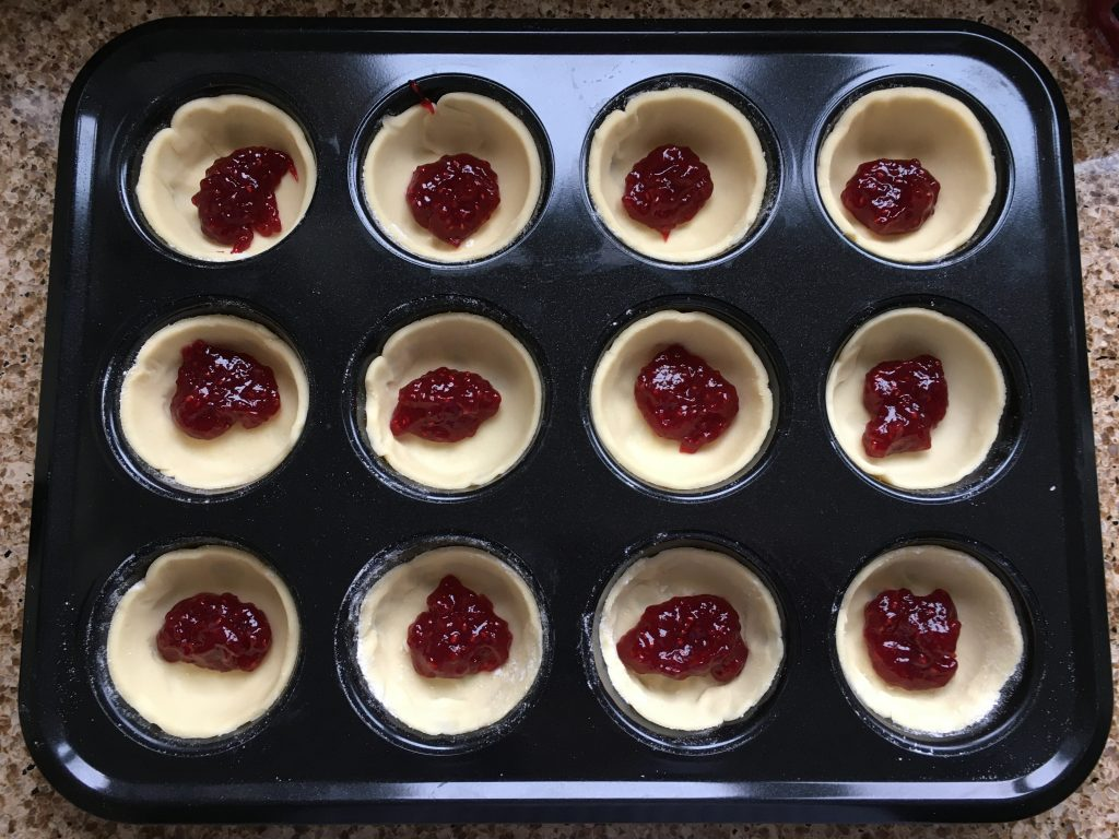 Gluten free pastry bases with raspberry jam for gluten free cherry Bakewell's
