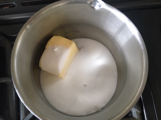 Butter and sugar in a saucepan. Ingredients for gluten free lemon drizzle cake.