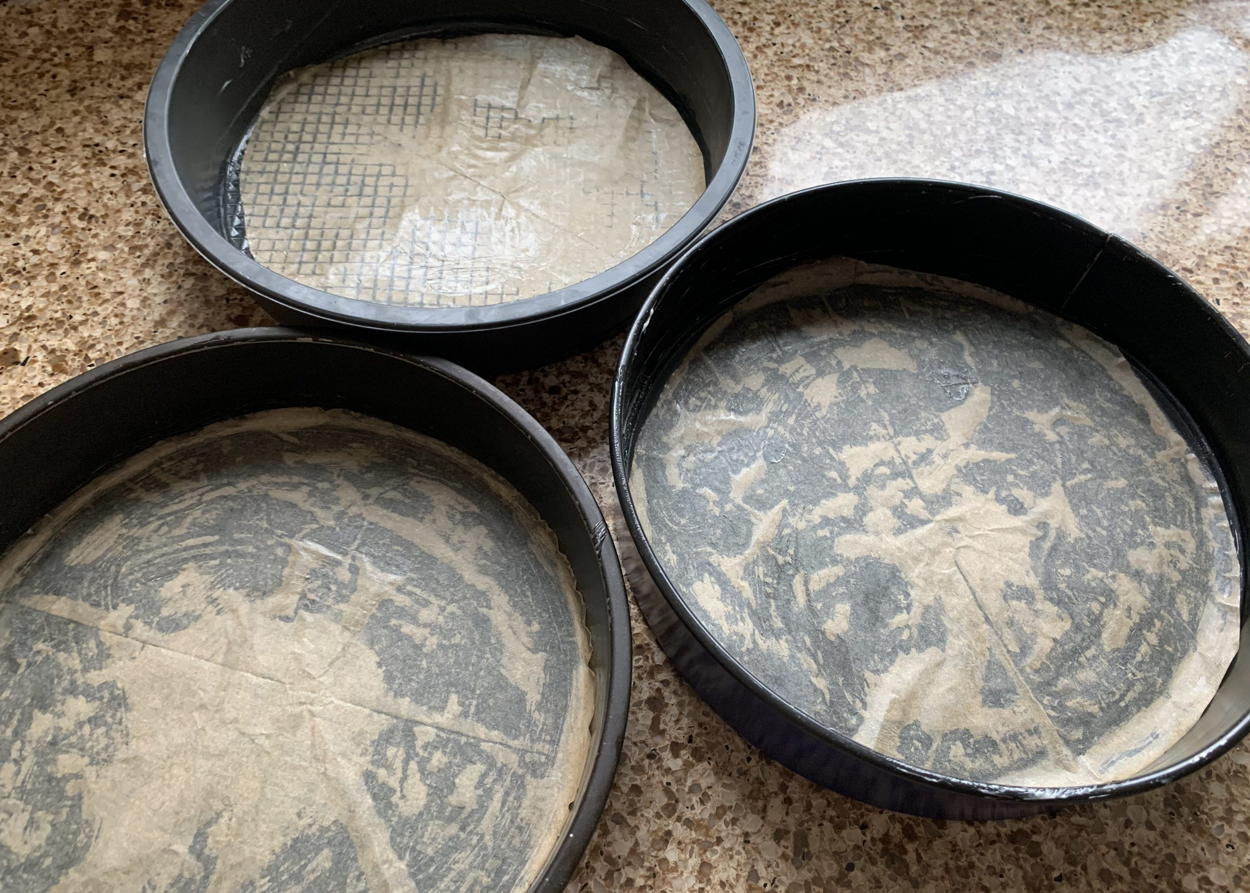 Lined and buttered tins for gluten free Black Forest gateau