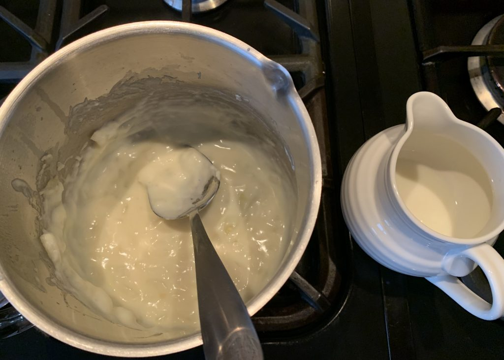 Butter, gluten free flour and onions for mini gluten free chicken and ham pies