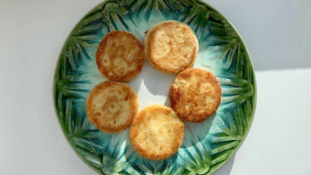 Gluten free potato cakes on a large green plate