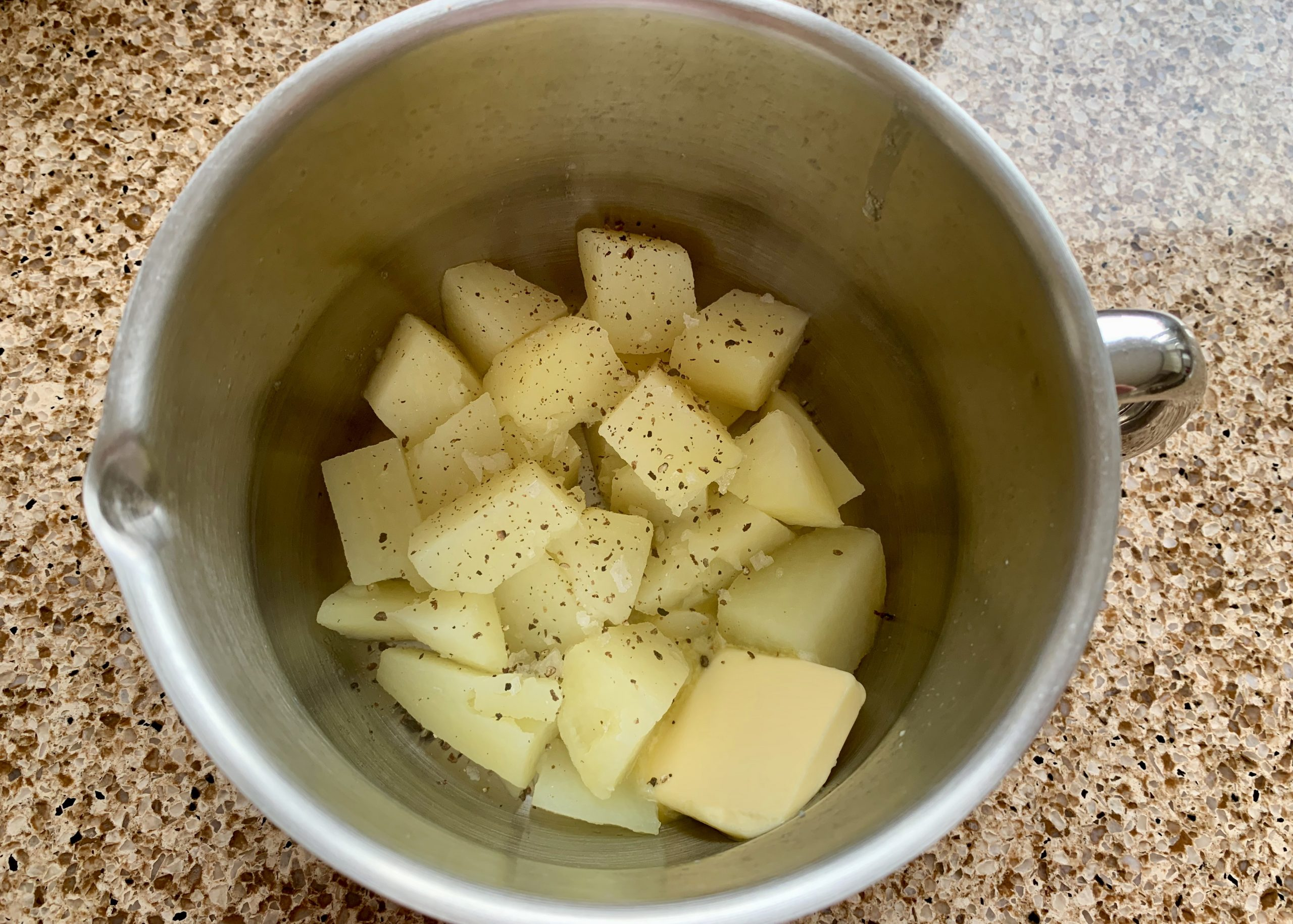 Diced potato and butter in a pan