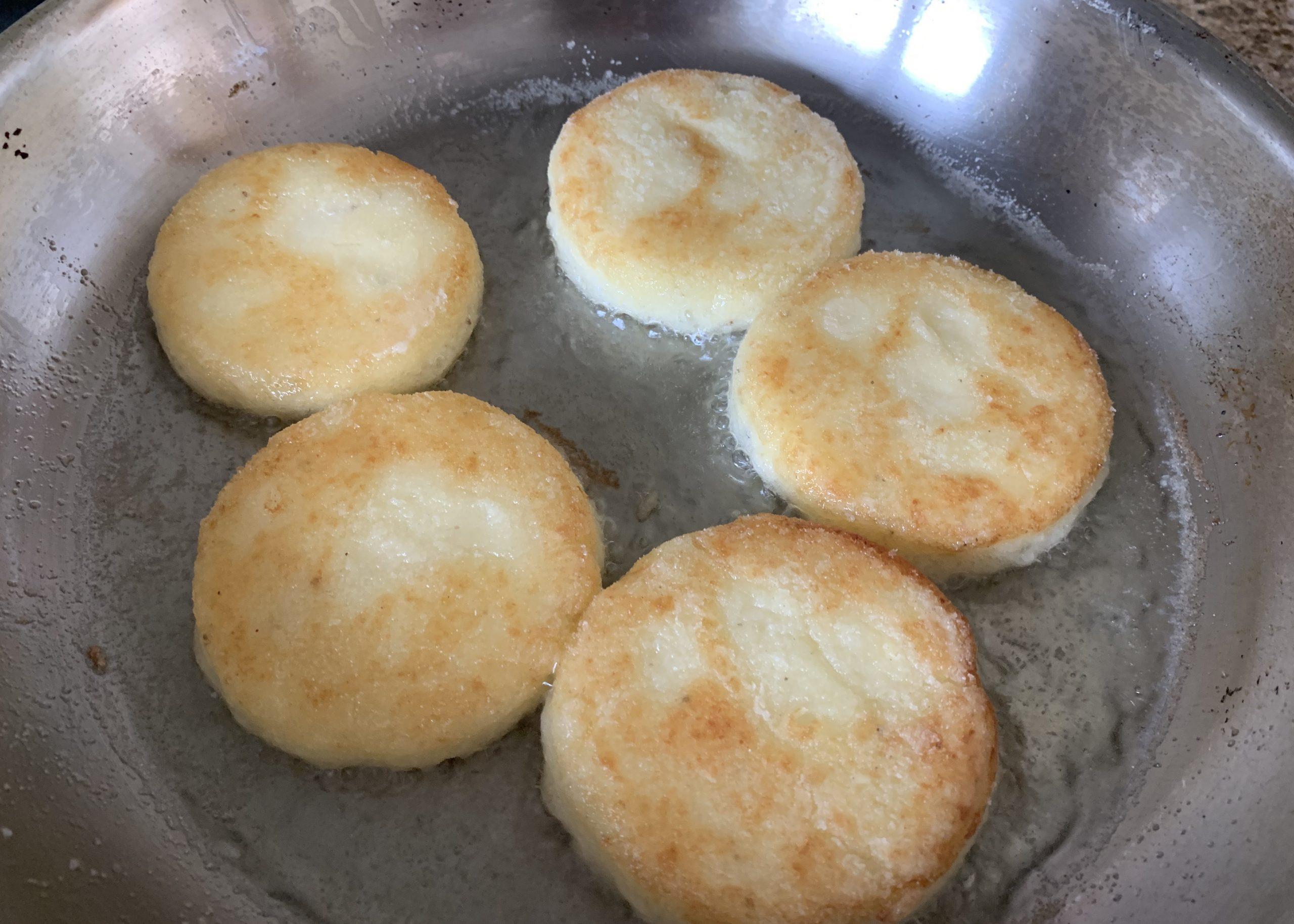 Gluten free potato cakes in a frying pan