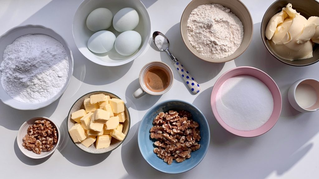 Ingredients laid out for gluten free coffee and walnut cake
