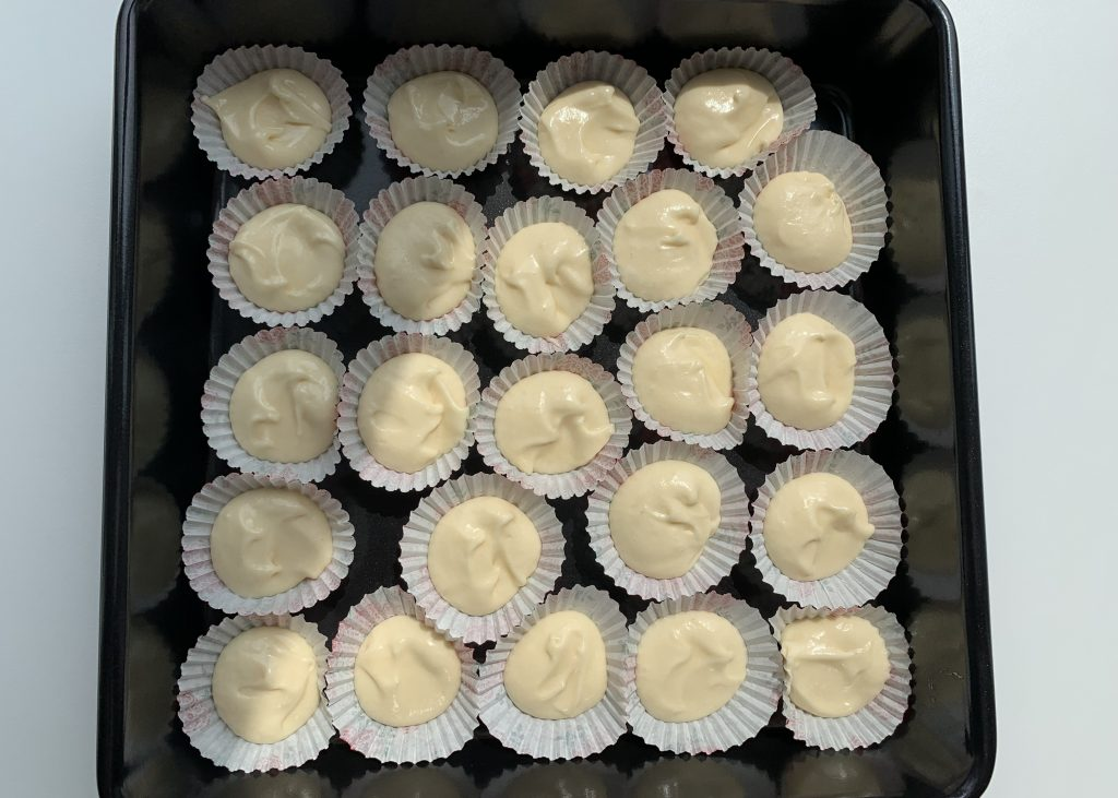 Petit four cases filled with gluten free sponge mixture
