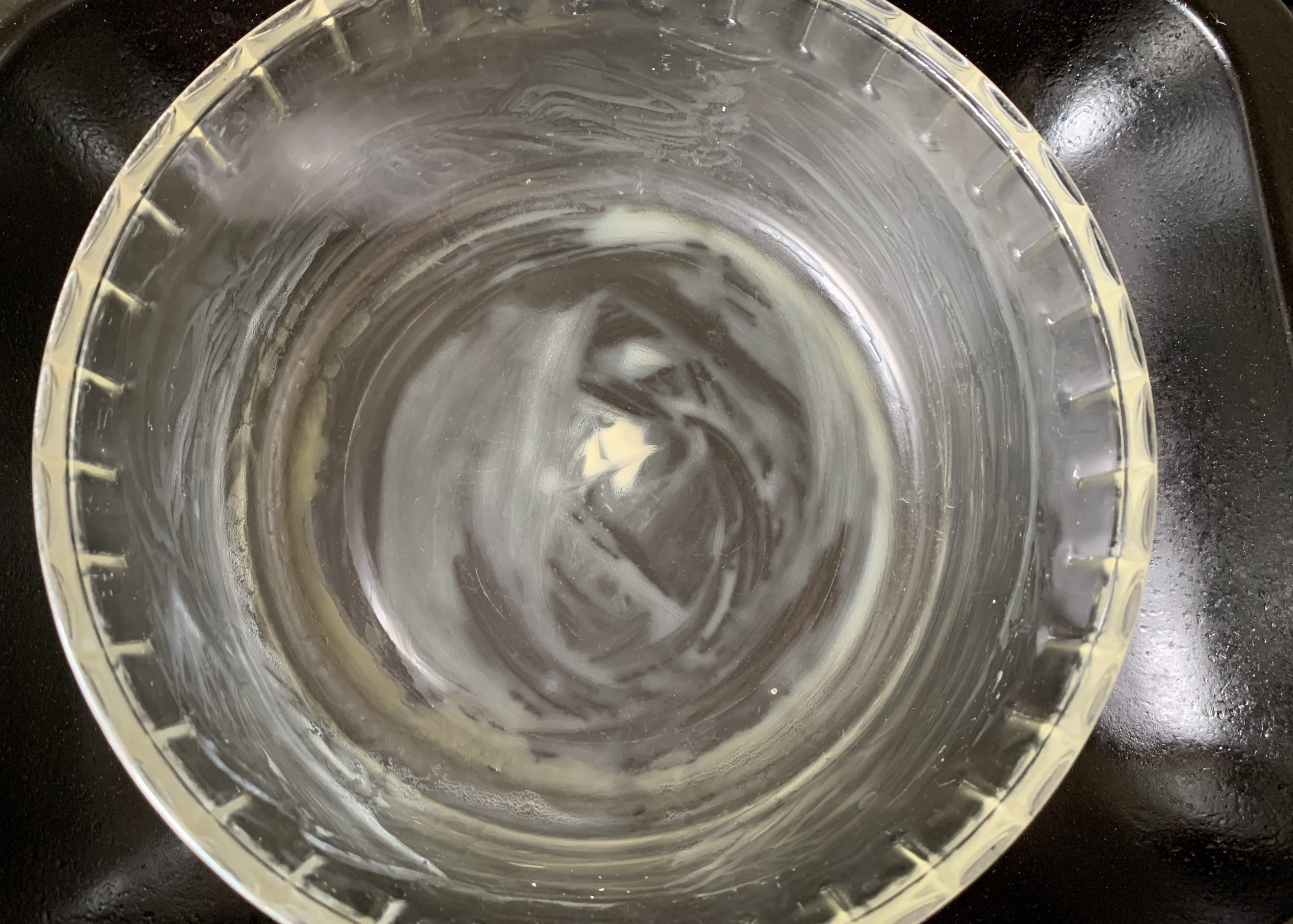 A buttered oven proof glass basin