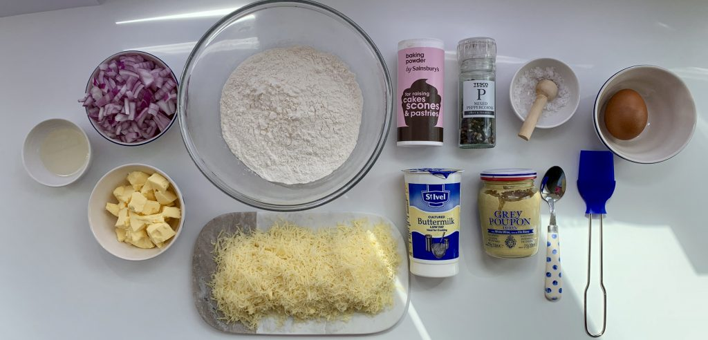Flat lay of ingredients forGluten free cheese and red onion buttermilk scones