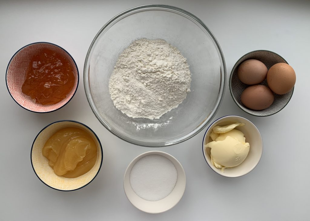 Flat lay of ingredients for citrus muffins