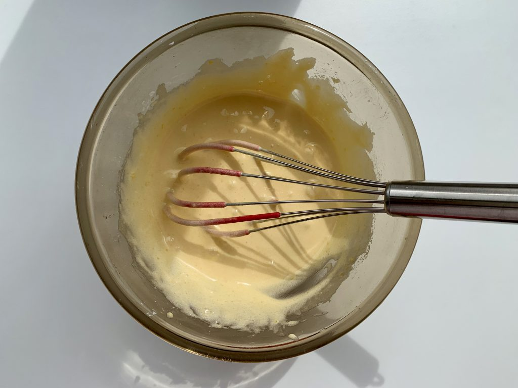Pastry cream mixture in a glass bowl prior to being cooked