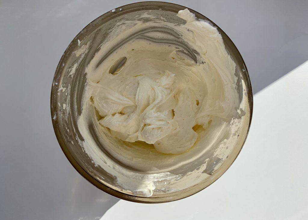 Vanilla buttercream in a pyrex bowl