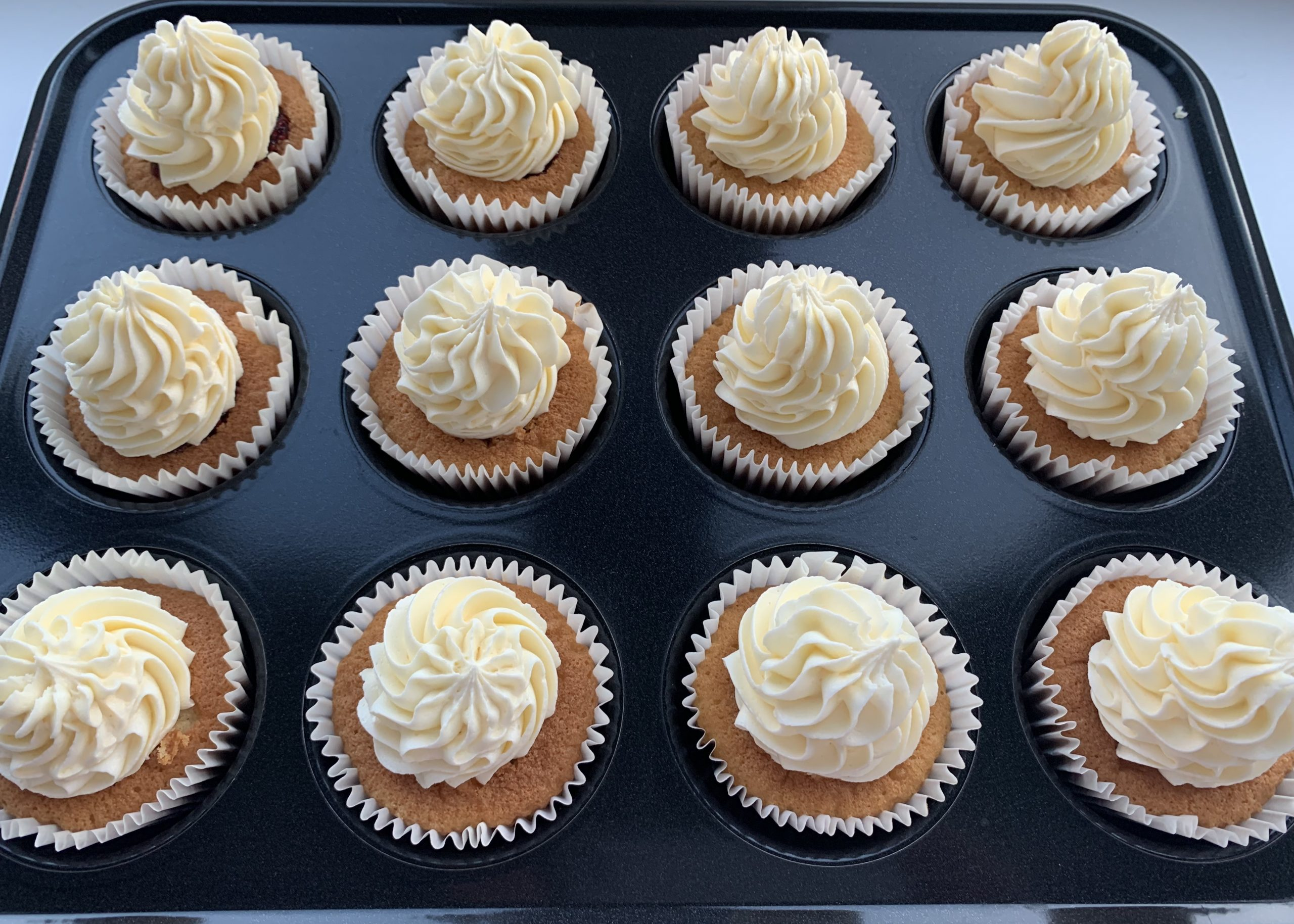 Gluten free butterfly cakes filled with raspberry jam and buttercream