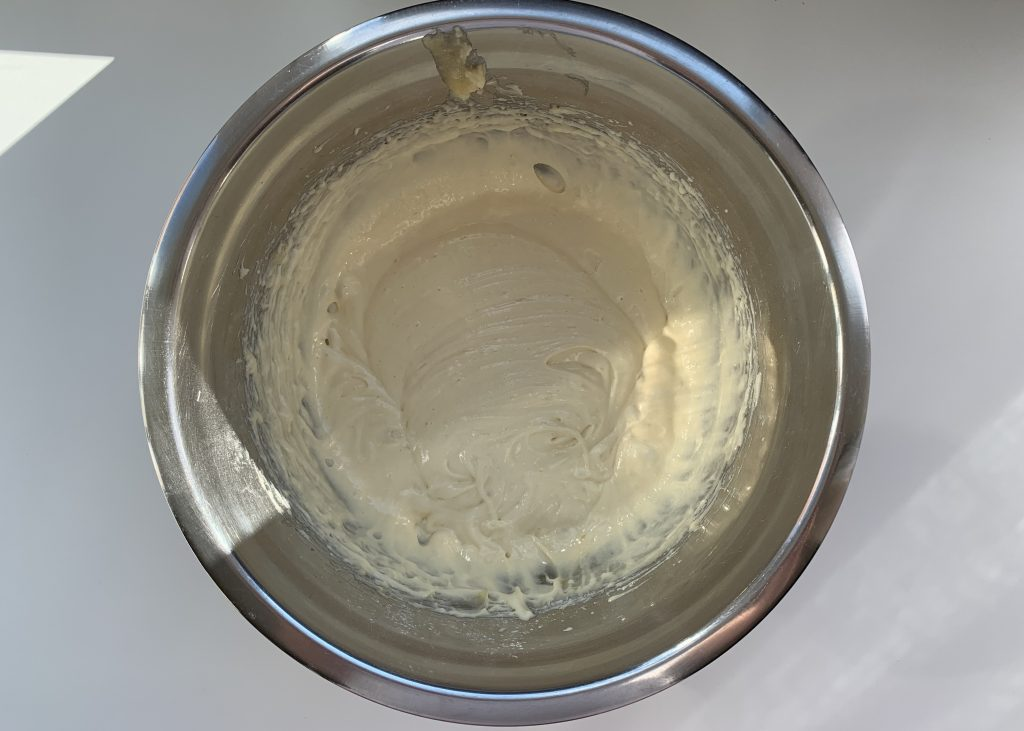Gluten free sponge mixture in a stainless steel bowl